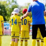 kids soccer team and their coach